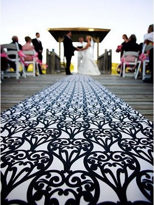 a plain white carpet aisle runner rents at 100 measures 3x20 wont stay put on a breezy day and may have stains on it from previous use